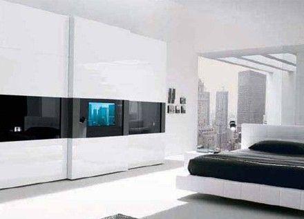 卧室衣柜设计效果图:想在卧室看电视,又不想牺牲能够摆放家具的